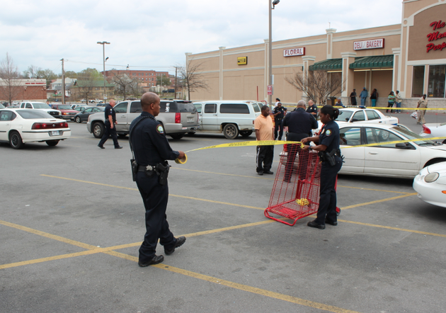 police-rope-off-a-crime-scene-after-shots-rang-out-in-the-parking-lot-of-a-little-rock-grocery-store-thursday