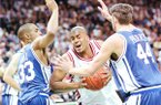 Duke's Grant Hill, left, and Cherokee Parks, right, try to contain Arkansas' Corliss Williamson during the first half of the NCAA championship game in Charlotte, N.C., Monday, April 4, 1994. (AP Photo/David Longstreath)