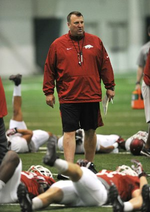 NWA Media/Michael Woods --04/03/2014-- w @NWAMICHAELW...University of Arkansas coach Bret Bielema watches his team get warmed up during Thursday afternoons practice in Fayetteville.