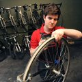 Phil McMeans, a University of Arkansas freshman from Waco, Texas, works on a road bicycle Thursday, ...