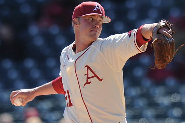 Arkansas starter Trey Killian delivers a pitch during the first inning against South Carolina Friday, April 4, 2014, at Baum Stadium in Fayetteville.