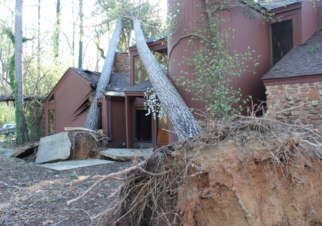 an-overnight-storm-blew-down-more-than-a-dozen-trees-around-this-home-across-from-camden-fairview-high-school-including-some-that-hit-the-structure