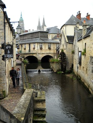 Pedestrians walk along the Aure River in Bayeux, France. The charming town sits just a few miles from the beaches of Normandy where Allied forces invaded on D-Day during World War II in 1944.