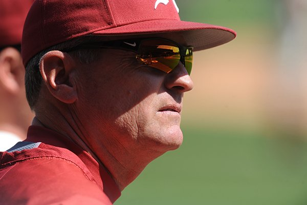 Arkansas coach Dave Van Horn watches from the dugout during play against South Carolina Friday, April 4, 2014, at Baum Stadium in Fayetteville.