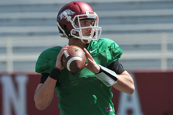 Arkansas quarterback Brandon Allen runs drills during practice Saturday morning at Razorback Stadium in Fayetteville.