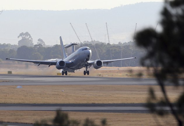 a-royal-australian-air-force-e-7a-wedgetail-takes-off-from-perth-airport-to-take-part-in-search-operations-for-the-missing-malaysia-airlines-flight-mh370-in-perth-australia-saturday-april-5-2014-the-air-and-sea-search-has-not-turned-up-any-wreckage-from-the-boeing-777-that-could-lead-searchers-to-the-plane-and-perhaps-its-flight-data-and-cockpit-voice-recorders-or-black-boxes