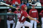 University of Arkansas batter Joe Serrano connects for a base hit with the basses loaded to drive in 3 runs in the second inning of the Saturday, April 5, 2014, game against South Carolina at Baum Stadium in Fayetteville.