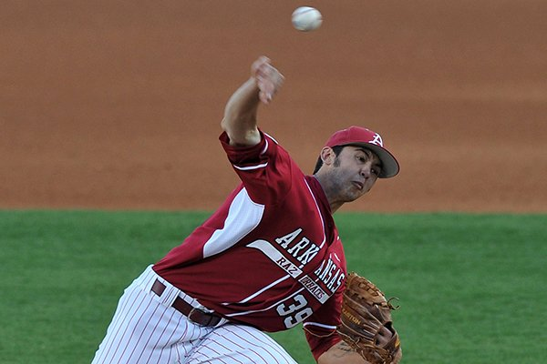 Arkansas pitcher Chris Oliver fires a pitch in the 4th inning of the Saturday, April 5, 2014, game against South Carolina at Baum Stadium in Fayetteville.