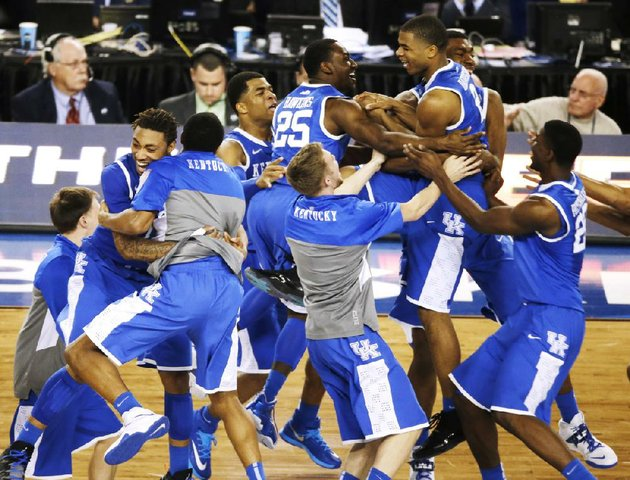 kentucky-celebrates-after-guard-aaron-harrison-made-a-three-point-shot-in-the-final-seconds-as-the-wildcats-defeated-wisconsin-74-73-in-the-second-ncaa-tournament-semifinal-saturday-at-att-stadium-in-arlington-texas