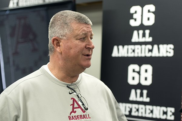 Dave Jorn, pitching coach at the University of Arkansas, talks with the media Friday, Feb. 7, 2014 at the University of Arkansas baseball media day at Baum Stadium in Fayetteville.