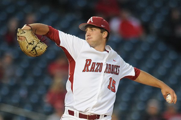 Arkansas starter Colin Poche delivers a pitch during the fourth inning against Nebraska Tuesday, April 1, 2014, at Baum Stadium in Fayetteville.