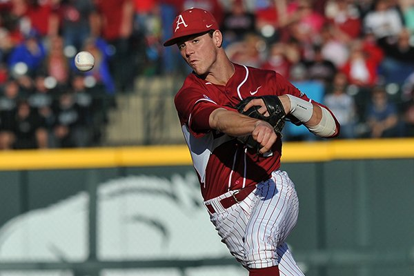 Arkansas second baseman Brian Anderson makes a play for an out in the first inning of a Saturday, April 5, 2014 game against South Carolina at Baum Stadium in Fayetteville.
