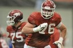 Arkansas tackle Dan Skipper runs drills during Thursday afternoon's practice in Fayetteville.