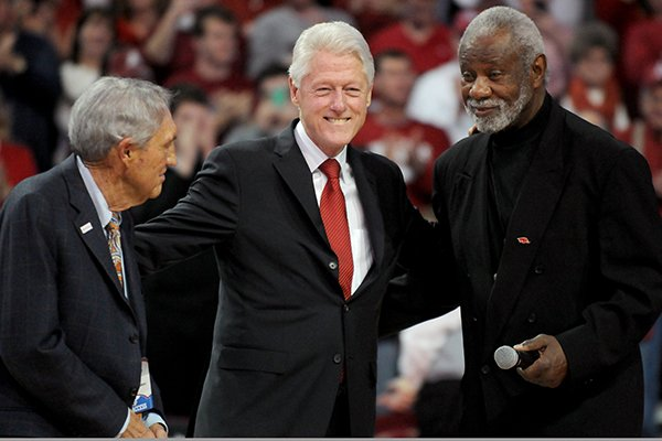 Eddie Sutton, President Bill Clinton and Nolan Richardson take part in a half-time ceremony in the game between Arkansas and LSU on Saturday, Feb. 15, 2014 in Bud Walton Arena in Fayetteville.