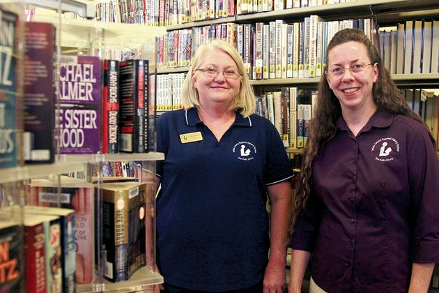 ramona-howell-left-goff-public-library-branch-manager-and-darla-ino-white-county-library-system-library-director-stand-among-the-books-at-the-the-new-goff-public-library-in-beebe