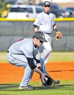 STAFF PHOTO BEN GOFF Josh Poulos, Springdale High third baseman, fields a ground ball Tuesday during Game 1 of the doubleheader against Bentonville at Bentonville's Tiger Athletic Complex.