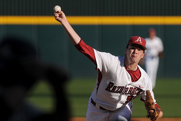 Arkansas pitcher Alex Phillips delivers the ball to a UNLV batter during the game in Baum Stadium in Fayetteville on Wednesday April 9, 2014. Arkansas won 9-2.