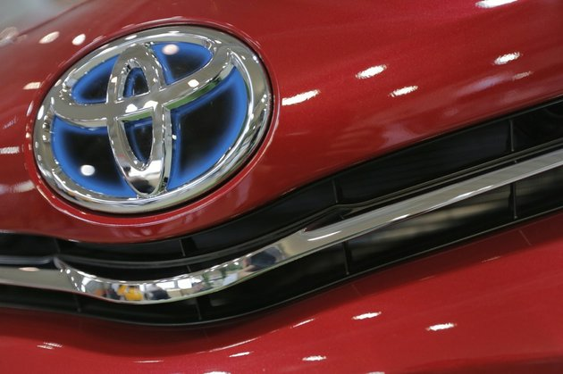 in-this-aug-2-2013-file-photo-the-emblem-of-a-toyota-car-shines-at-toyota-motor-corps-showroom-toyota-mega-web-in-tokyo