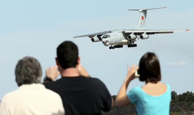 spectators-take-photos-of-a-chinese-ilyushin-il-76-aircraft-as-it-comes-in-for-a-landing-at-perth-international-airport-after-returning-from-the-ongoing-search-operations-for-missing-malaysia-airlines-flight-370-in-perth-australia-thursday-april-10-2014