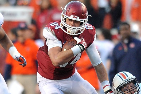 Arkansas tight end Hunter Henry makes a catch as he tries to shake Auburn defender Jake Holland during the second quarter of a Nov. 2, 2013 game at Razorback Stadium in Fayetteville.