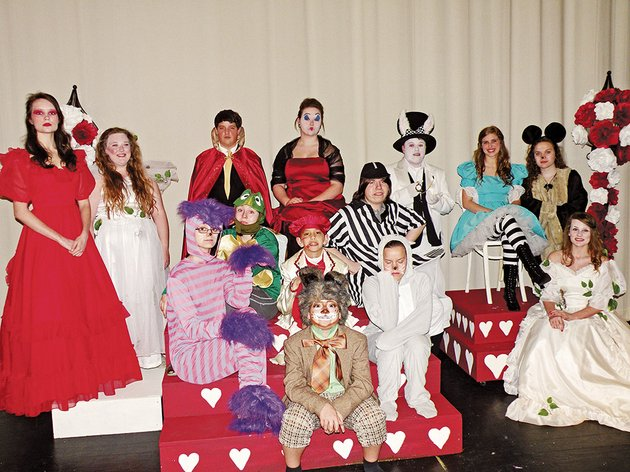 the-clinton-high-school-drama-department-will-present-alices-adventures-in-wonderland-at-7-pm-thursday-and-friday-and-3-pm-saturday-at-the-clinton-high-school-auditorium-members-of-the-cast-include-front-row-chase-blanton-as-the-march-hare-second-row-from-the-left-caitlin-hill-as-the-cheshire-cat-gavin-smith-as-the-knave-of-hearts-and-juliana-parish-as-the-dormouse-third-row-from-the-left-tiffany-burns-as-the-mock-turtle-dalton-james-as-tweedledum-and-ashley-gallaher-who-appears-as-the-white-queen-in-two-of-the-performances-and-fourth-row-from-the-left-whitney-wilkins-as-the-red-queen-jennifer-lovell-who-appears-as-the-white-queen-in-three-of-the-performances-including-two-for-students-only-on-wednesday-josh-pryor-as-the-king-of-hearts-alexus-stutzman-as-the-queen-of-hearts-caleb-pryor-as-the-white-rabbit-kayla-meeler-as-alice-and-rebecca-willingham-as-the-mouse