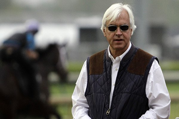 Trainer Bob Baffert watches morning workouts at Churchill Downs Monday, April 29, 2013, in Louisville, Ky. (AP Photo/Garry Jones)