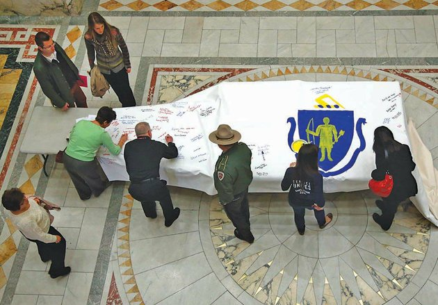 the-associated-press-tragedy-remembered-people-sign-the-america-4-prayer-canvas-in-remembrance-of-the-2013-boston-marathon-bombing-victims-and-survivors-on-friday-at-the-statehouse-in-boston-three-people-were-killed-and-more-than-260-injured-in-the-bombing