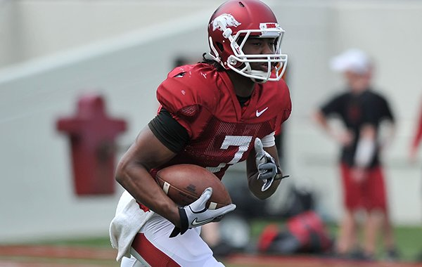 Arkansas quarterback Damon Mitchell runs back a punt as the Razorbacks run drills before the start of Saturday's football scrimmage at Razorback Stadium in Fayetteville.