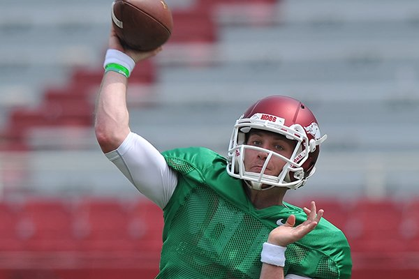 Arkansas quarterback Austin Allen runs drills before the start of Saturday's football scrimmage at Razorback Stadium in Fayetteville.