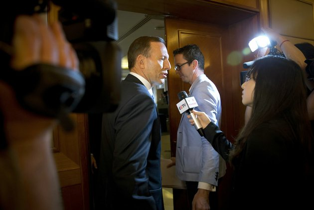 australian-prime-minister-tony-abbott-center-is-questioned-by-a-chinese-tv-reporter-about-the-missing-malaysian-airlines-flight-370-after-a-press-conference-saturday-at-a-hotel-in-beijing-china-with-no-new-underwater-signals-detected-the-search-for-the-missing-malaysian-passenger-jet-resumed-saturday-in-a-race-against-time-to-find-its-dying-black-boxes-five-weeks-after-families-first-learned-their-loved-ones-never-arrived-at-their-destination