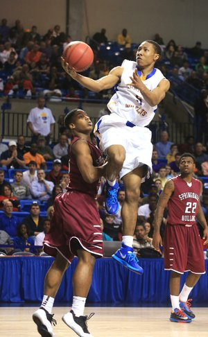 Arkansas Democrat-Gazette/RICK MCFARLAND --03/13/14--  North Little Rock's Kevaughn Allen (5) drives on Springdale in the State Class 7A Boys Championship game in Hot Springs Thursday.