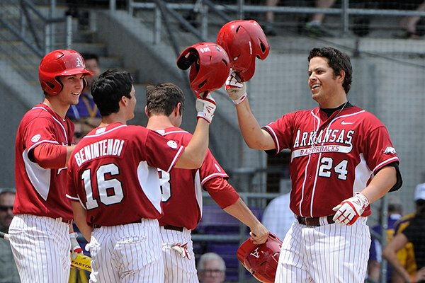 Arkansas' Blake Baxendale (24) connects on a grand slam home run in the first inning of a game against LSU Sunday, April 13, 2014 at Alex Box Stadium in Baton Rouge, La. Arkansas won 10-4.