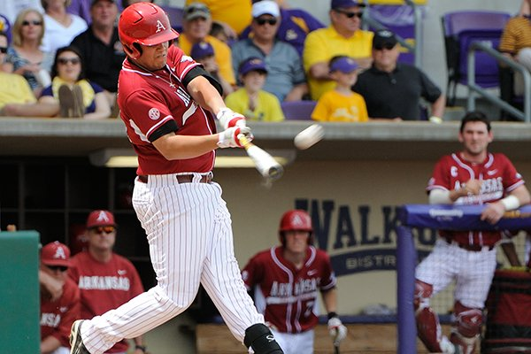 Arkansas' Blake Baxendale (24) connects on a grand slam home run in the first inning of a game against LSU Sunday, April 13, 2014 at Alex Box Stadium in Baton Rouge, La. Arkansas won 10-4. (Photo by Chris Daigle)
