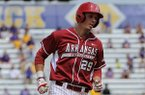 Arkansas' Eric Fisher rounds third base after hitting a two-run home run in the fifth inning of a game against LSU Sunday, April 13, 2014 at Alex Box Stadium in Baton Rouge, La. Arkansas won 10-4.