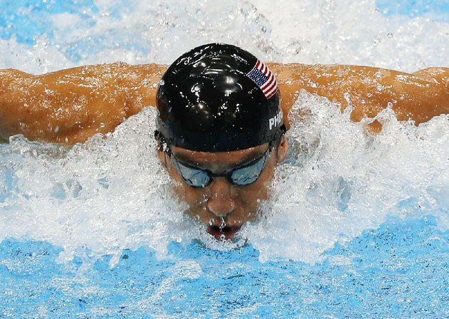 file-in-this-aug-4-2012-file-photo-united-states-michael-phelps-swims-in-the-mens-4-x-100-meter-medley-relay-at-the-aquatics-centre-in-the-olympic-park-during-the-2012-summer-olympics-in-london-phelps-is-coming-out-of-retirement-the-first-step-toward-possibly-swimming-at-the-2016-rio-olympics-bob-bowman-the-swimmers-longtime-coach-told-the-associated-press-on-monday-april-14-2014-that-phelps-is-entered-in-three-events-the-50-and-100-meter-freestyles-and-the-100-butterfly-at-his-first-meet-since-the-2012-london-games-at-a-meet-in-mesa-ariz-on-april-24-26-ap-photojulio-cortez-file