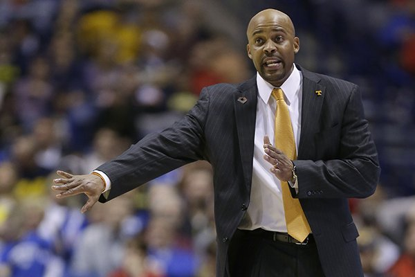 in-this-march-28-2014-file-photo-tennessee-head-coach-cuonzo-martin-directs-his-team-during-the-second-half-of-an-ncaa-midwest-regional-semifinal-college-basketball-tournament-game-against-michigan-in-indianapolis-cal-announced-the-hiring-of-tennessees-martin-tuesday-april-15-2014-he-replaces-mike-montgomery-who-retired-last-month-after-six-seasons-in-berkeley-ap-photomichael-conroy-file