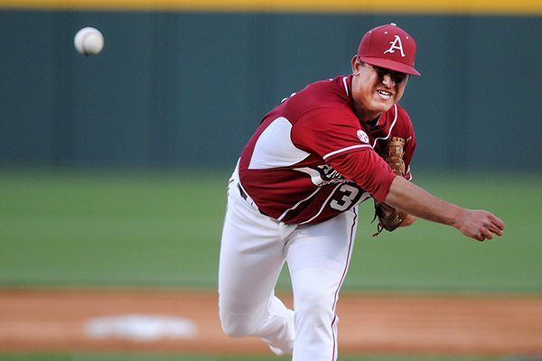 Arkansas' Jacob Stone delivers a pitch Tuesday, April 15, 2014, during the game against Stephen F. Austin at Baum Stadium in Fayetteville. Stone relieved starting pitcher Alex Phillips.