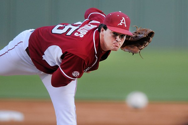 Arkansas' Alex Phillips delivers a pitch Tuesday, April 15, 2014, during the game against Stephen F. Austin at Baum Stadium in Fayetteville