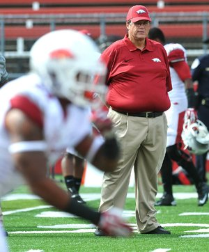 NWA Media/MICHAEL WOODS --09/21/2013--   University of Arkansas offensive coordinator Jim Chaney works with the team before the start of the Razorbacks game against the Rutgers Scarlet Knights at High Point Solutions Stadium in Piscataway , New Jersey.