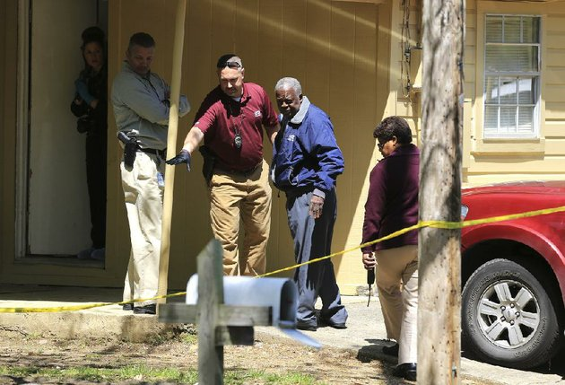 little-rock-police-investigate-the-crime-scene-tuesday-at-a-house-in-the-4100-block-of-tatum-street-where-a-woman-found-the-body-of-her-co-worker-in-the-house-and-called-the-police-about-11-am-police-are-treating-the-death-as-a-homicide