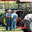 Photo by Randy Moll Tractor enthusiasts visit at a past Tired Iron of The Ozarks show. The show gives visitors a chance to see how people lived and how the land was farmed years ago.