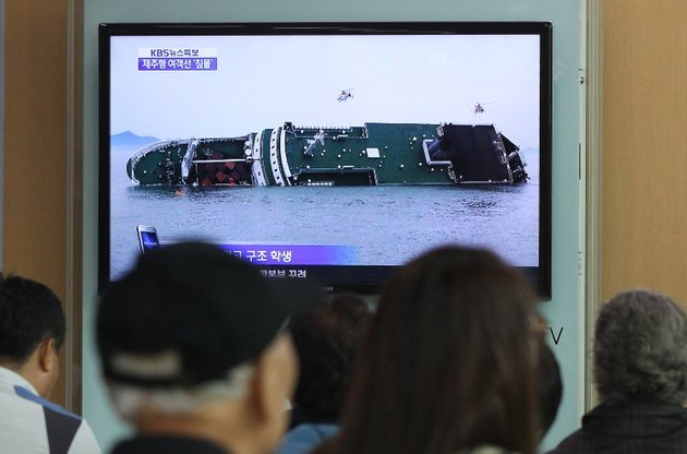 seoul-south-korea-a-ferry-carrying-459-people-mostly-high-school-students-on-an-overnight-trip-to-a-tourist-island-sank-off-south-koreas-southern-coast-on-wednesday-leaving-nearly-300-people-missing-despite-a-frantic-hours-long-rescue-by-dozens-of-ships-and-helicopters-at-least-four-people-were-confirmed-dead-and-55-injured