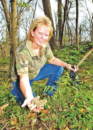 STAFF PHOTO FLIP PUTTHOFF Sheila Edwards had success finding morel mushrooms on this hunt near Farmington in 2012.
