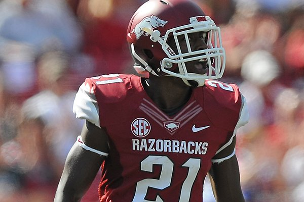 Arkansas' Carroll Washington celebrates breaking up a pass Oct. 12, 2013, during the first quarter of the game against South Carolina at Donald W. Reynolds Razorback Stadium in Fayetteville.
