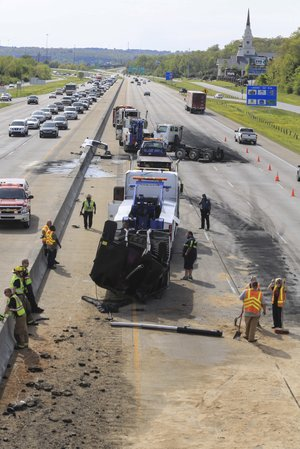 Arkansas Democrat-Gazette/STATON BREIDENTHAL --4/17/14-- Workers clean debris off of the westbound lanes of Interstate 40 near the North Hills Boulevard overpass after a dump truck hit the bridge Thursday afternoon.