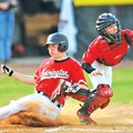 STAFF PHOTO ANDY SHUPE Adam Ness of Farmington slides in safely Thursday at the plate as Pea Ridge c...