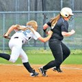 STAFF PHOTO BEN GOFF Morgan Neal, Springdale Har-Ber shortstop, tags out Bentonville runner Alicia L...