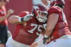 Arkansas offensive lineman Luke Charpentier runs drills during practice Thursday, April 10, 2014 in Fayetteville.