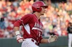 Arkansas first baseman Eric Fisher rounds the bases after hitting a home run during the game against Vanderbilt on Friday April 18, 2014, at Baum Stadium.