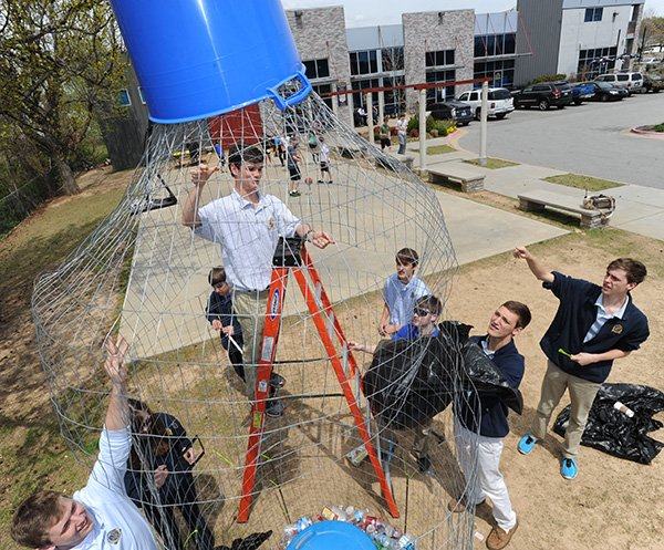 haas-hall-academy-seniors-hays-osborne-19-top-alex-walker-18-right-and-thomas-coger-18-bottom-join-other-students-in-assembling-a-large-bottle-shaped-container-constructed-of-wire-thursday-april-17-2014-meant-to-collect-recyclable-plastic-bottles-at-the-school-in-fayetteville-the-schools-green-team-is-collecting-bottles-for-a-second-year-to-raise-awareness-of-the-amount-of-bottles-that-are-used-but-not-recycled-in-advance-of-earth-day-which-is-tuesday